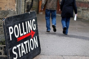 Voters enter a polling station