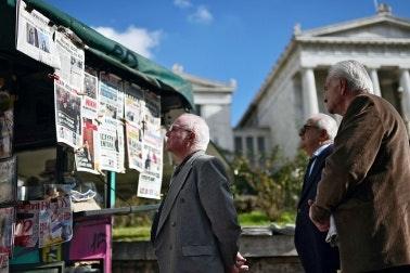 Men at a newsstand