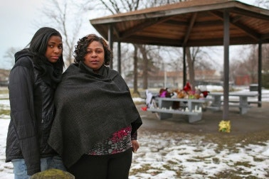 Mother and daughter at memorial