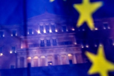 Greek Parliament seen behind an EU flag