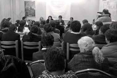 Women gathered for a panel discussion