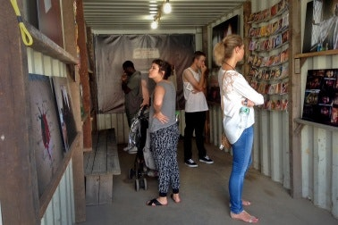People viewing artwork at Photoville