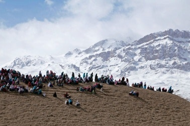People gathered on a mountain ridge