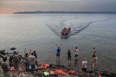 A boat nears the shore