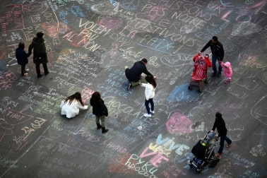 People write chalk messages on the pavement