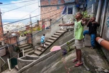 Children standing on pavement