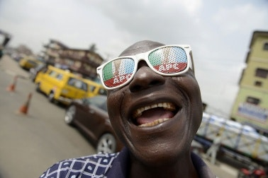 A man wearing novelty sunglasses