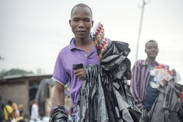 Mayeso Gwanda holding bags and merchandise