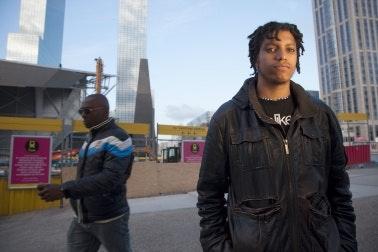 A man standing in a pedestrian plaza