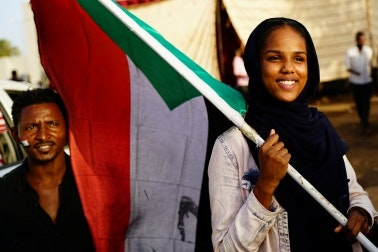 A woman holding a flag