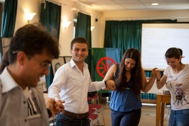Barvalipe participants holding hands and dancing.