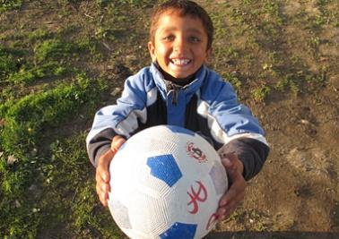 Mentor Malluta holding a soccer ball