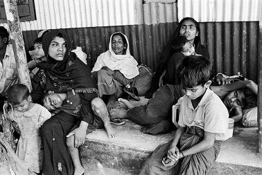 Women and children sitting.