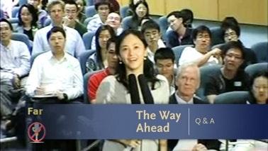 Audience member speaking into microphone
