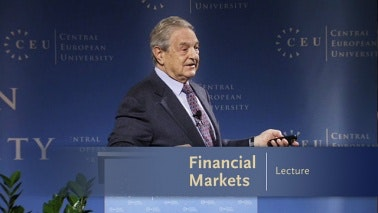 George Soros standing at a podium