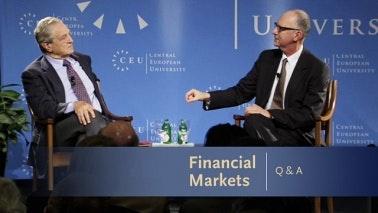 George Soros being interviewed on stage