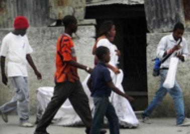 Betty Laurent walks down street in wedding gown