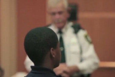 A young man in a courtroom