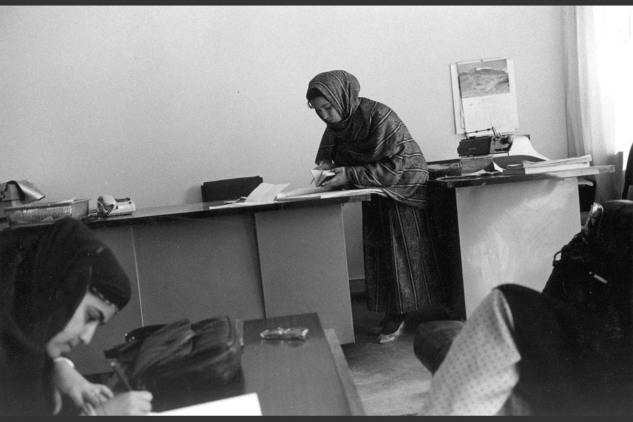 Two women working in an office.