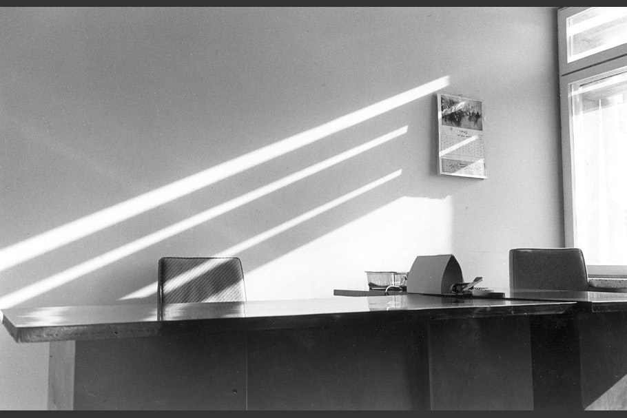 Sunbeams across an empty office.