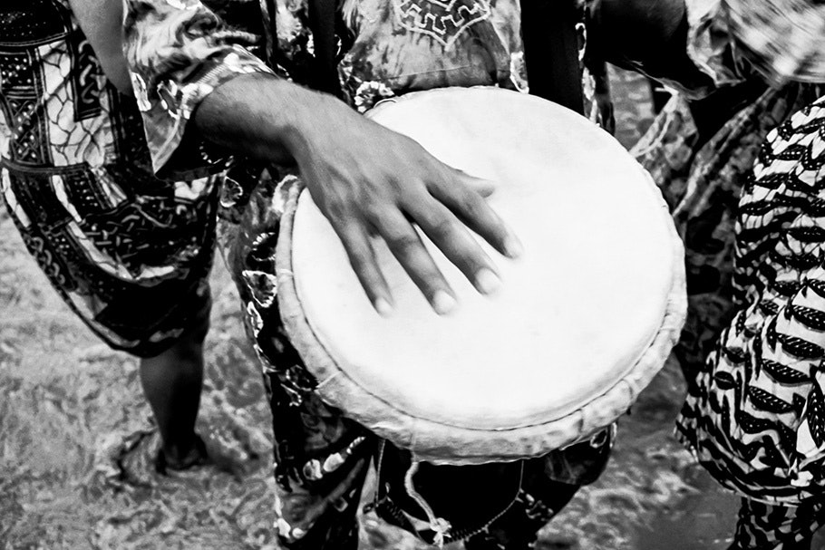 A hand playing a drum.