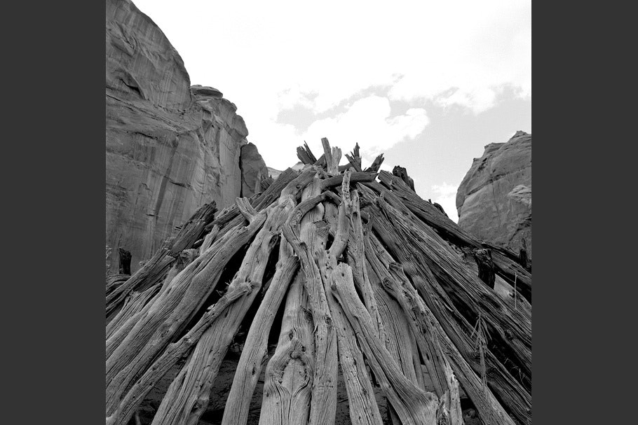 A grave made of piled wood.