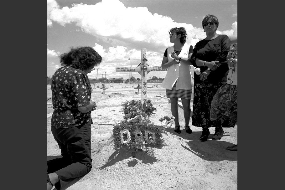 A family at a gravesite.