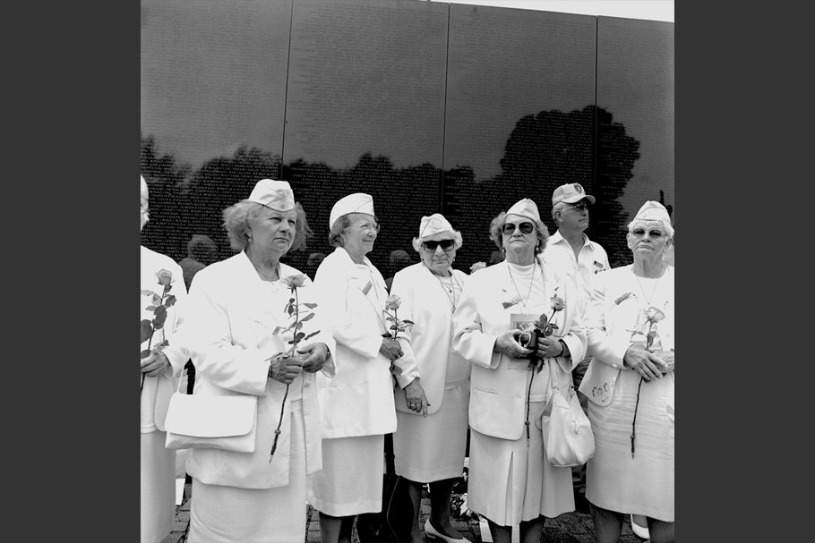 Women in uniform at the Vietnam Memorial.