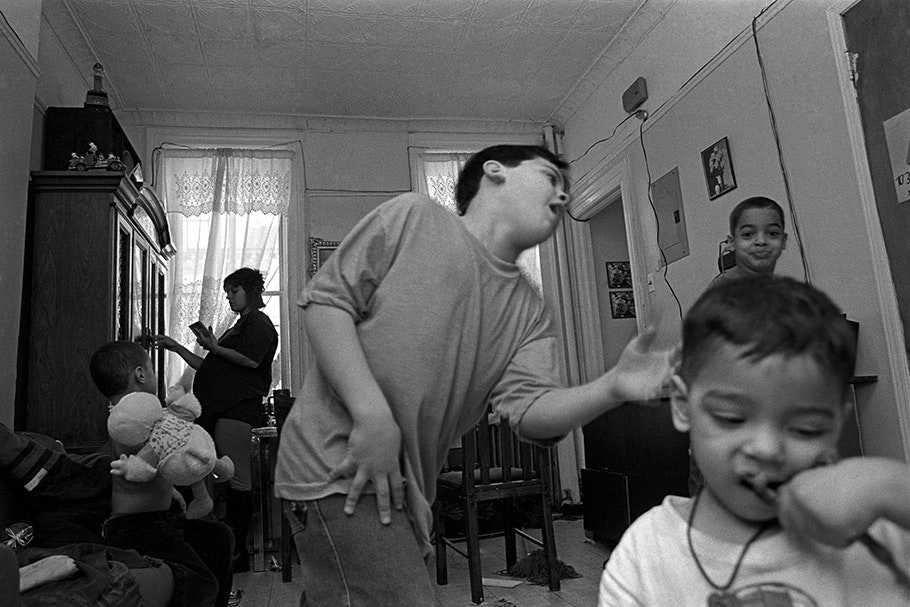 A group of children, one dancing.
