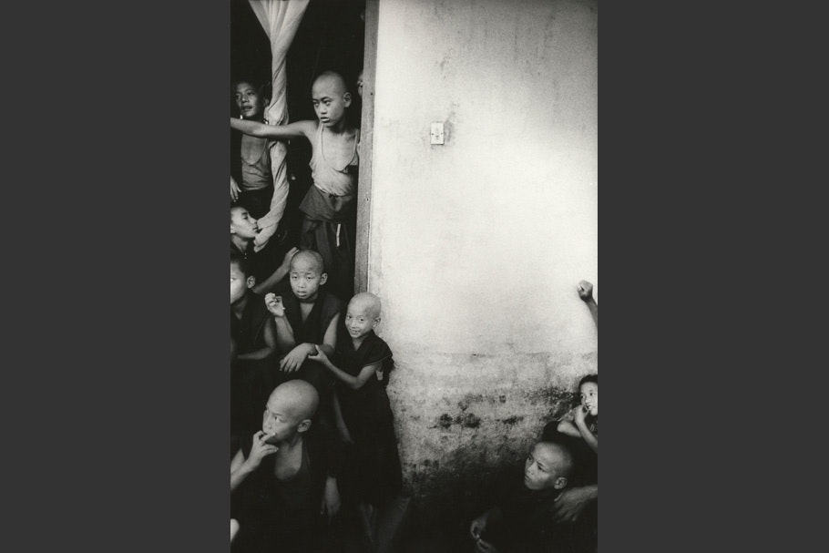 A group of young monks in a doorway.