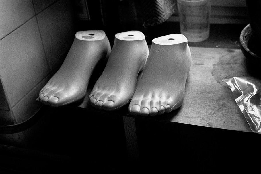 Three prosthetic feet.