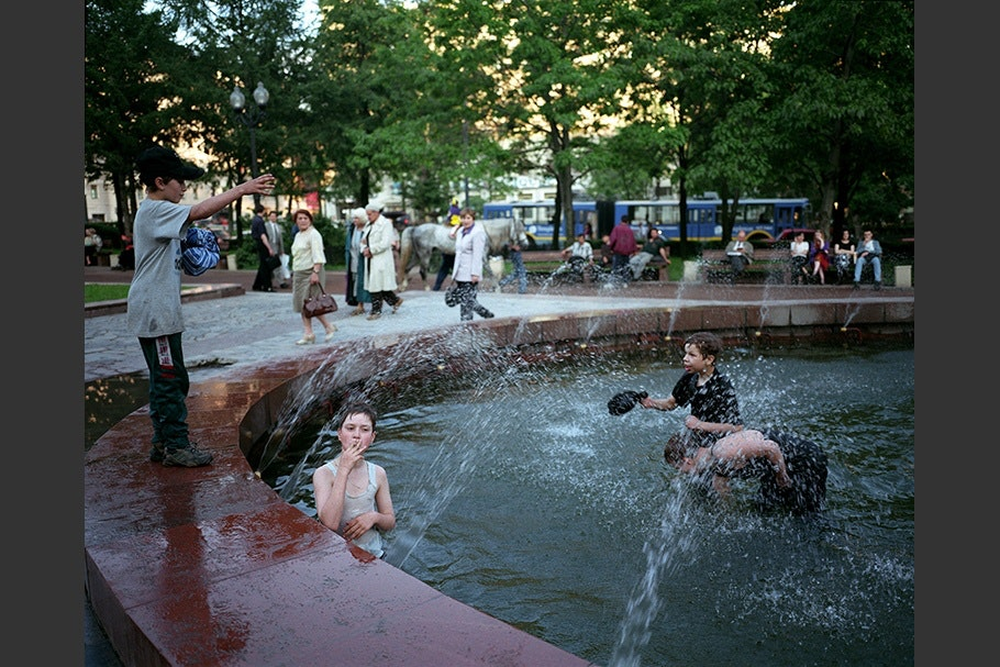 Boys playing in a fountain.