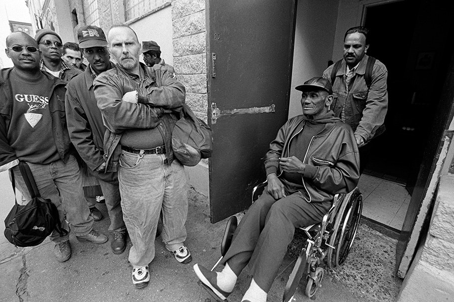 A group of men, with one in a wheelchair.