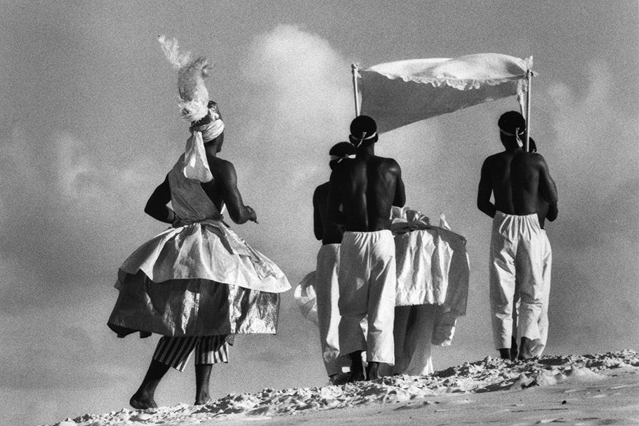 A ritual procession of people in costume.