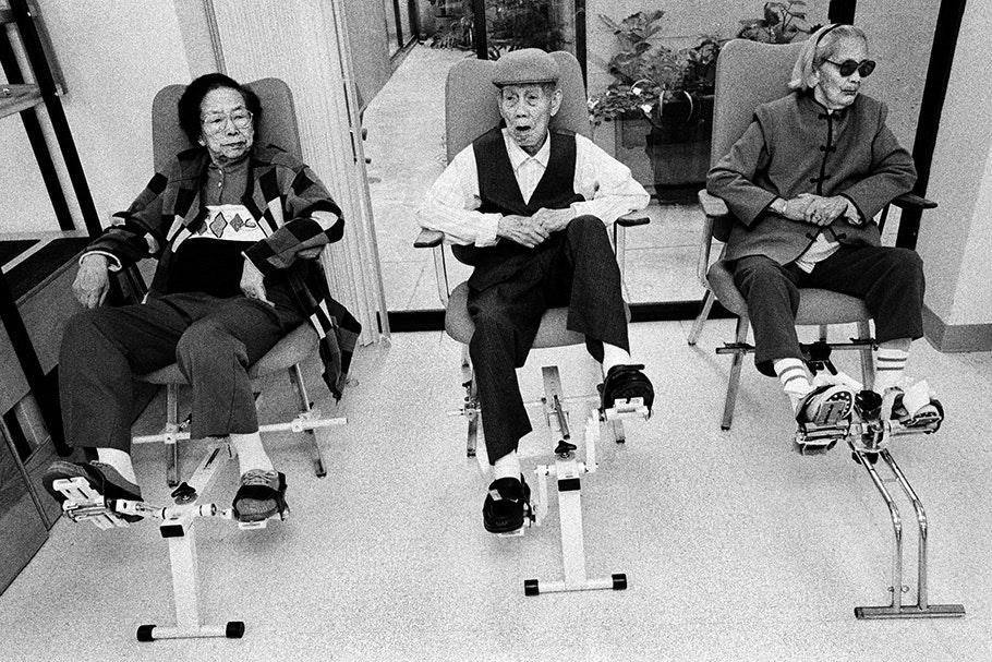 Three senior citizens on exercise bikes.