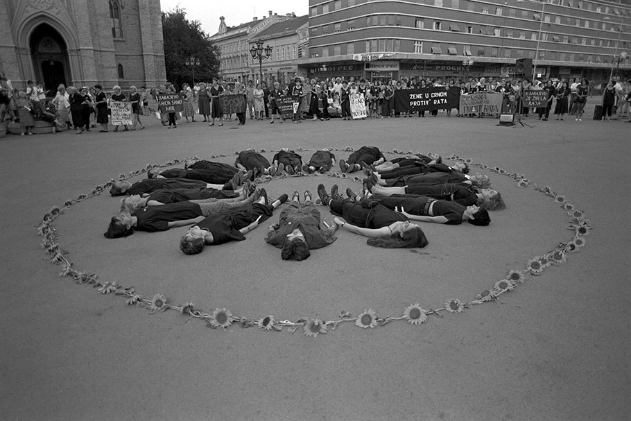 Protesters and flowers arranged in a circle.