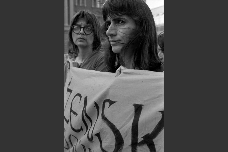 Two women holding a banner.
