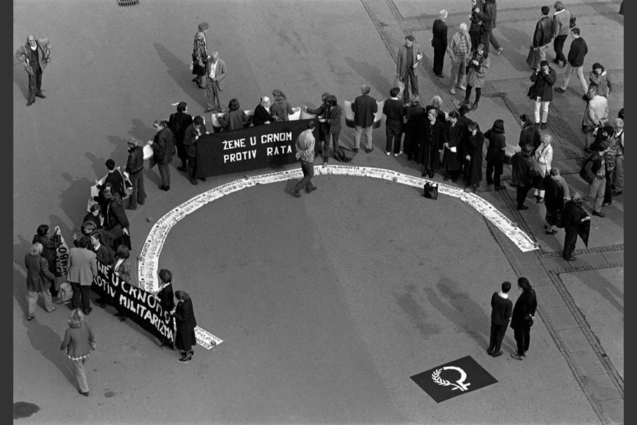 Protestors and signs in a semicircle.
