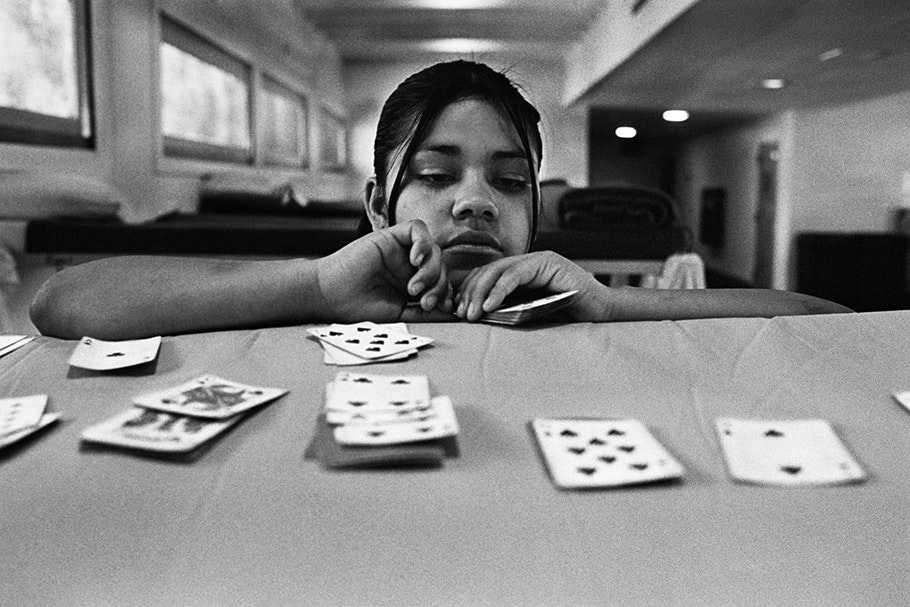 A girl playing cards.