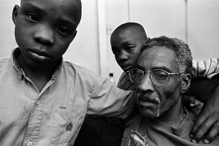 A grandfather with two grandsons.