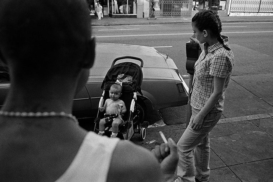 Parents and a child in a stroller.