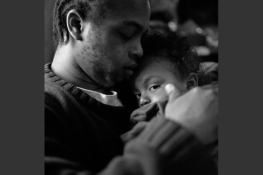 A father holds his son.