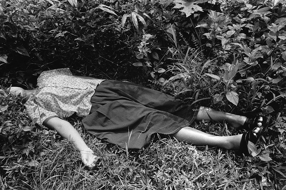 A woman lying in the grass.