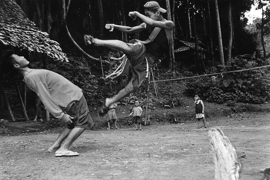 Two men fighting.