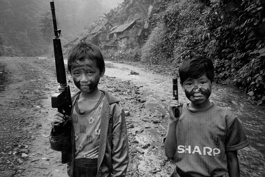 Two boys with guns.