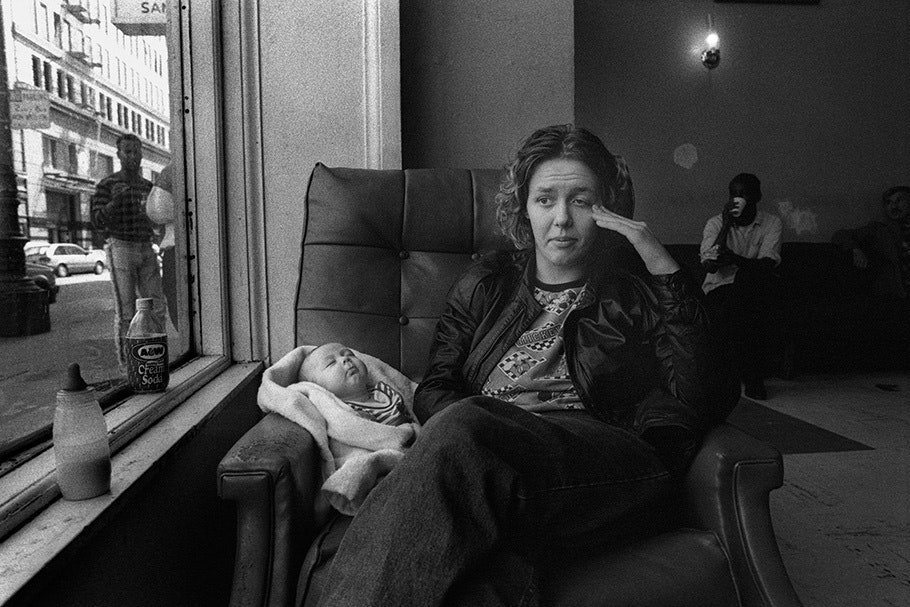 A woman with a baby in an armchair.