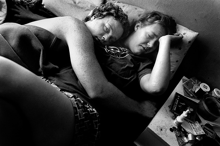 A couple embracing in bed.