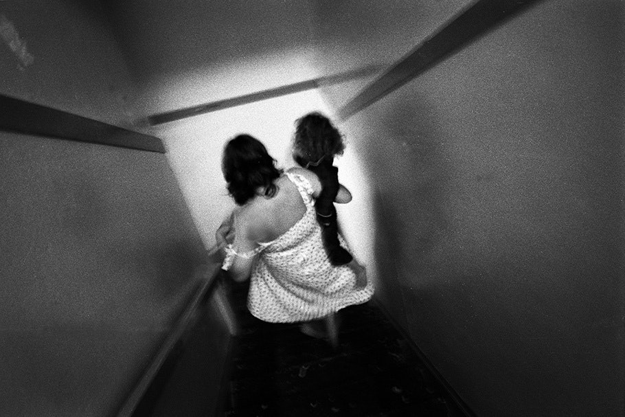 A mother and daughter walk down stairs.