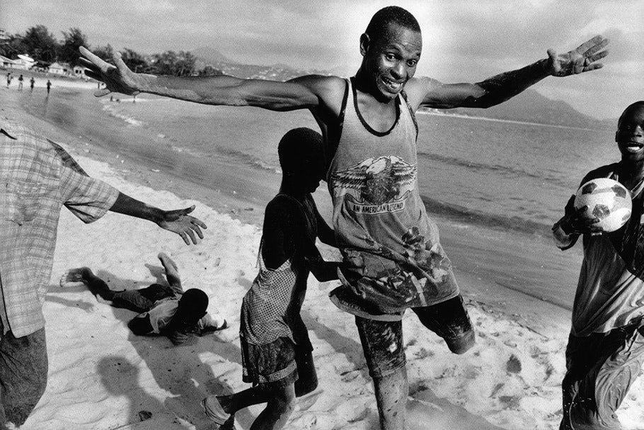 A soccer game on the beach.