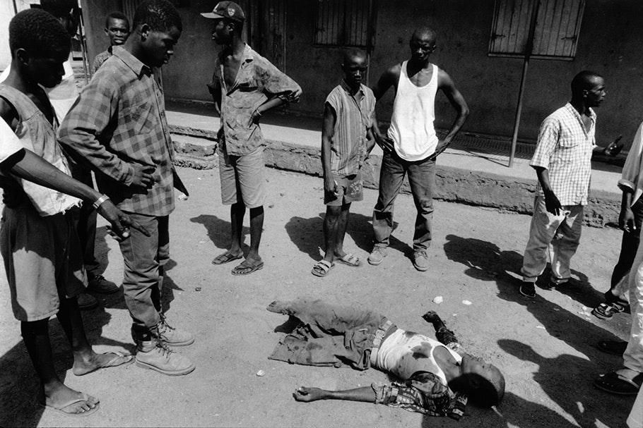 A boy dying on a street.